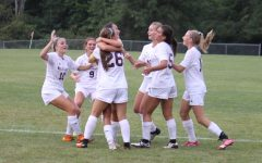 The team celebrates a goal scored against Twinsburg.
