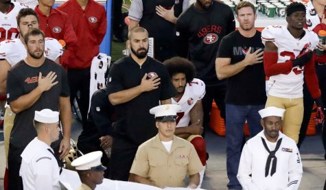 Photo of Colin Kaepernick kneeling during the national anthem