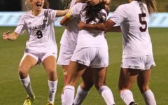 Walsh Jesuit women's soccer team celebrates after senior Sofia Rossi scores.