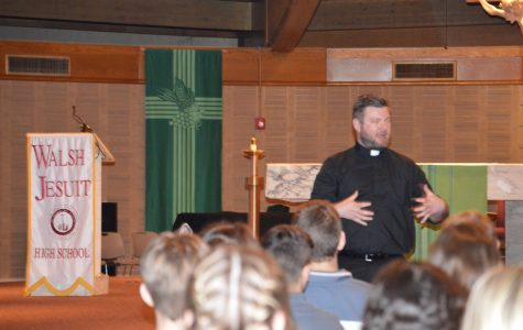 Mr. Arms shares his story and speaks about vocations to the religious life at a recent school assembly.