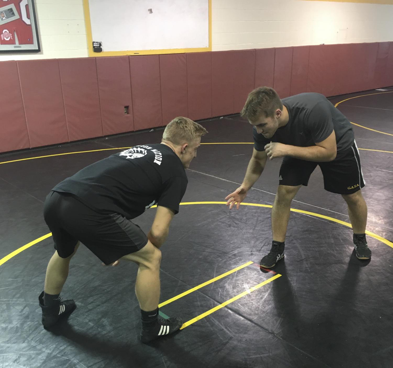 Juniors Adam Salek and Nolan Flanagan wrestle in preparation for this year's Ironman Tournament.