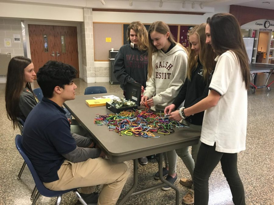 Students in the Commons purchase bracelets as a fundraiser for those encountered on a summer mission trip to Guatemala.