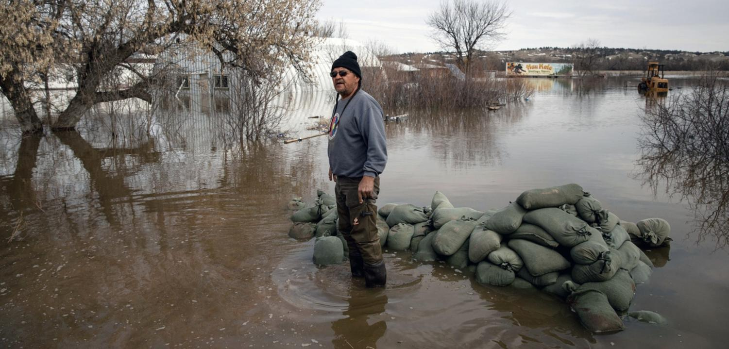 At Pine Ridge Indian Reservation, S.D., Henry Red Cloud surveys the damage done by the spring 2019 flooding.