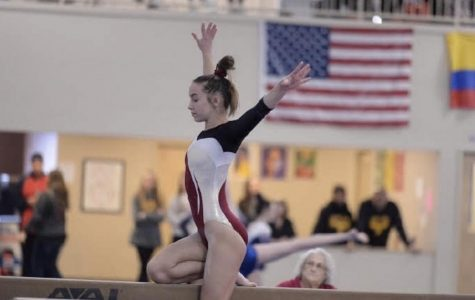 Sophomore Leah Sherman competes on the balance beam during a recent competition at First Flips Gymnastics in Solon.