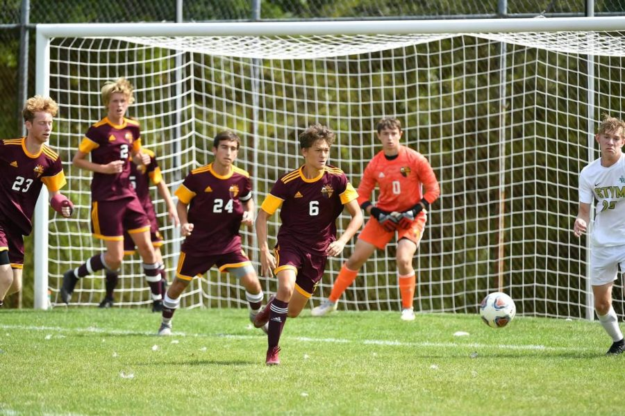 Junior Michael Robusto leads a break away with seniors Michael McShannic and Zach Marshall STVM.