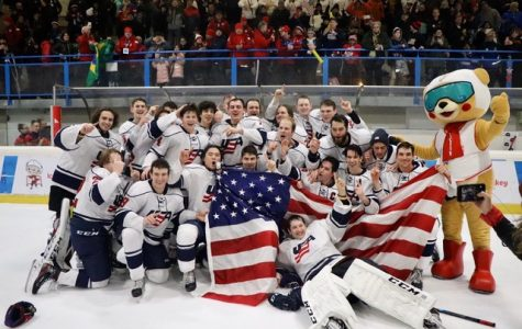 The 2019 Winter Deaflympics men's hockey gold medal team poses for a photo after their victory over Canada.