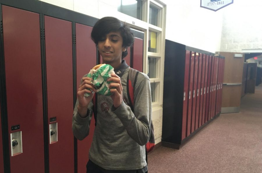 Junior Kunal Jain eagerly unwraps his BK Impossible Whopper to get a taste of what the fuss is all about.