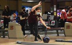 Junior Emily Wilson displays perfect form in the match against Akron East.