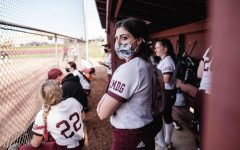 Miranda Herbele and teammates in the dugout in their game against St. Vincent/St. Mary  on April 26.