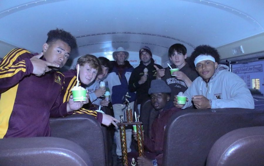 The men's and women's teams celebrated their wins with ice cream after the Crown Conference Meet. The men's team is shown here on the bus headed home.